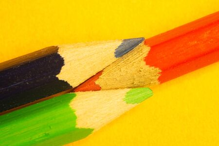 Colorful pencils isolated on yellow background. drawing supplies