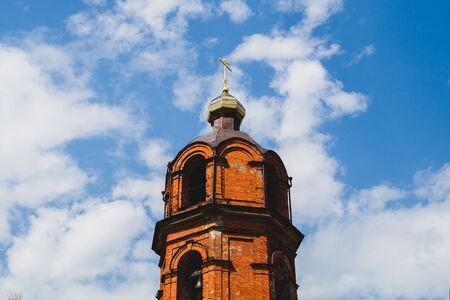 Beautiful old church tower with the cross background