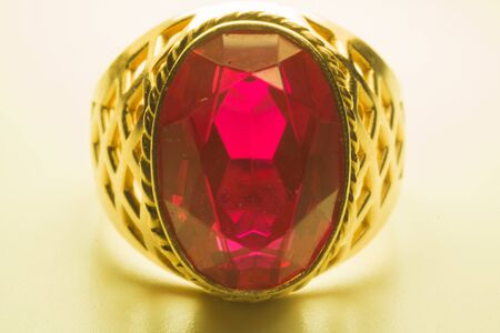 Golden ring with ruby isolated on white background Reklamní fotografie