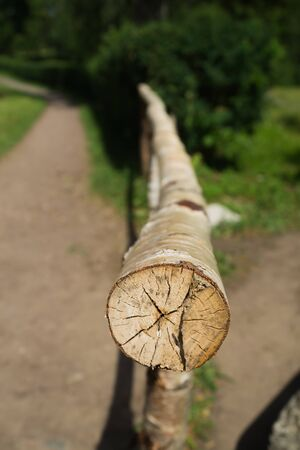 Wooden log fence. handrails from wood. rural scene