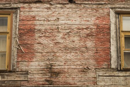 Windows of the old wooden house. wooden plank wall with windows background. copy dpace Stock Photo