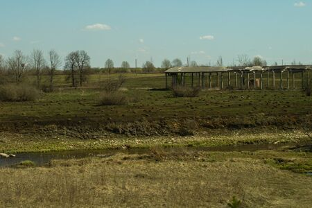 Old abandoned building in the forest. ruined cowshed. rural landscape Stock Photo