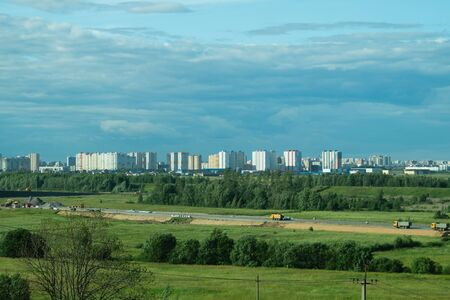 Urban cityscape panoramic view. horizon line with buildings. nature landscape with town and forest. blue sky. city into a distance
