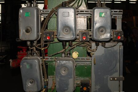 Retro switch box system. old power panel with buttons in the factory. industrial background Stock Photo
