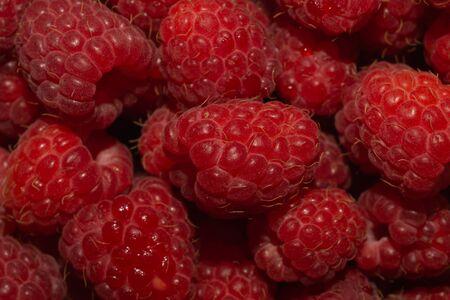 Fresh raspberry close up. ripe raspberries. red berry macro background