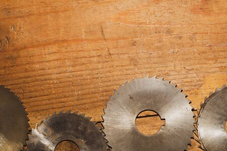 Circular saw blades. carpentry tools. industrial background. equipment for sawmill and sawing wooden products