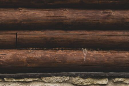 Wall of logs. wood background. rural house exterior