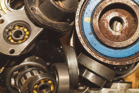 Metal bearings. pile of gears. scrap metal