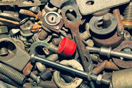 Pile of fasteners and screws close up. scrap metal. different metal parts