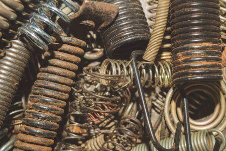 Metal rusty springs. pile of absorbers. industrial concept. work tool