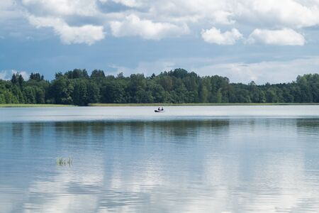 Fishermen catching fish on the lake. fishers on a fishing boat. calm background Stok Fotoğraf