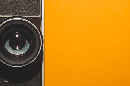 Vintage camera on yellow background. copy space Standard-Bild
