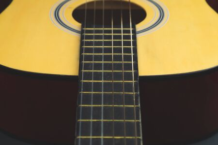 Acoustic guitar close up. musical instrument. strings on the guitar neck