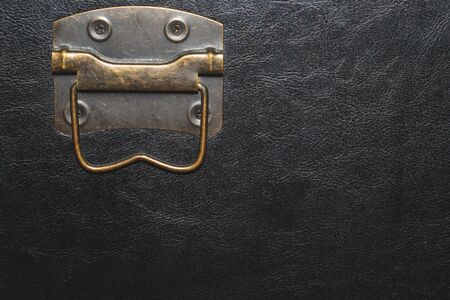 Metal handle with black leather background