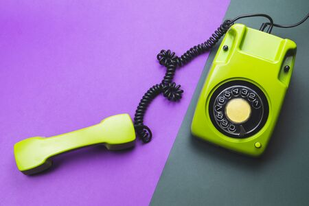 Classic phone with handset. vintage green telephone with phone receiver isolated on color background. old communication technology. copy space