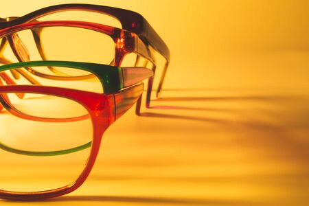 Glasses close up artistic shot. rimmed eyeglasses background with copy space. various reading glasses