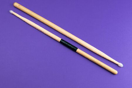A pair of wooden drumsticks isolated on color background. copy space Stock Photo