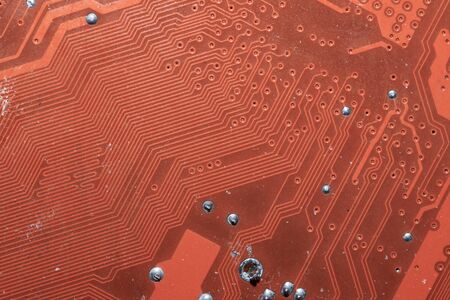 Spoiled motherboard close up. circuit board with dust and defects. modern technologies. micro elements of computer with connections and traces. Intelligent technology abstract background