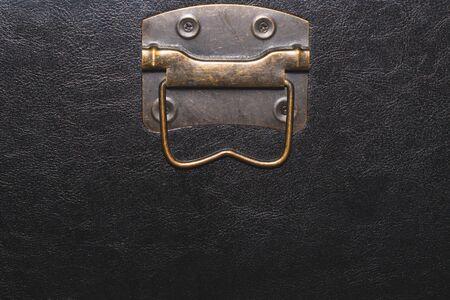 Metal handle with black leather background Reklamní fotografie - 140461487