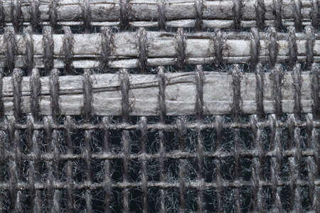 Braided fibers close up. woven texture. wicker background. knitted surface. weaving pattern. stitches of thread Stock Photo