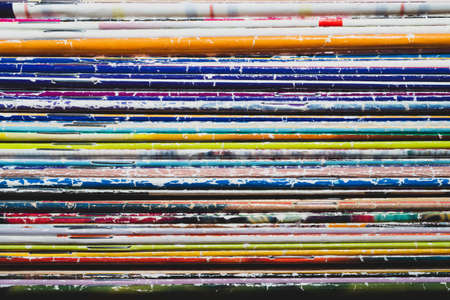 Stack of old magazines. pile of retro newspapers. vintage journals lie on top of each other. colorful background from the printed publications Banque d'images