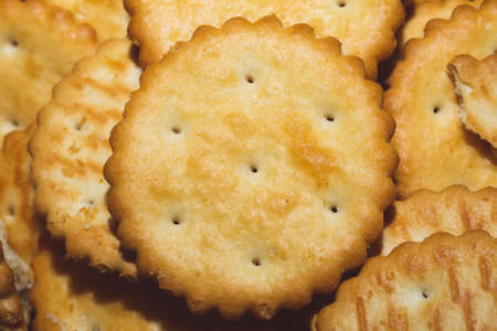 Round crackers background. crispy cookies. pile of biscuits