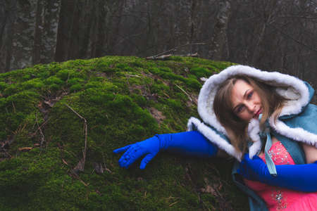 Woman with a mantle in the forest. adult woman in fantasy costume with cape