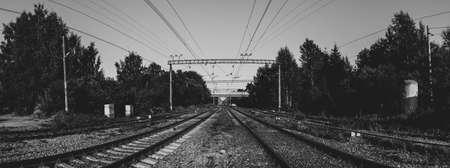 Railroad tracks perspective view black and white. steel rails go into the distance