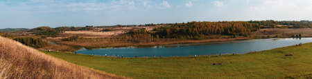 Pilgrims walk along the lake in the valley. nature landscape panorama aerial view Stock Photo