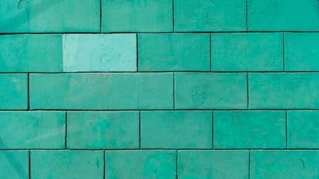 Brick wall is painted mint green color. stone background