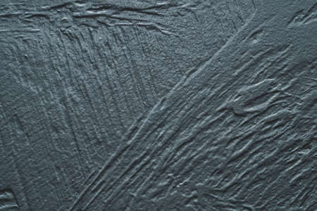 Gray concrete texture. rough painted background. uneven cement wall close up