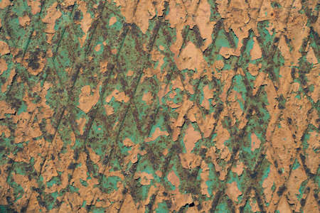 Old steel plate with rhombus shapes pattern. iron rusted surface with shabby paint. metal texture background