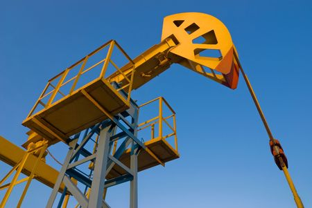 oilwell: Oil pumpjack against blue sky