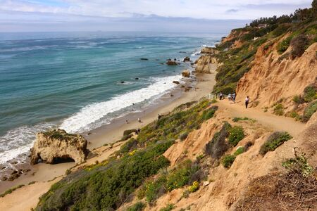 Amazing El Matador State Beach in Malibu in beautiful California in the United States. Showing the pathway to the beach with visitors. Stock Photo