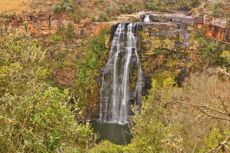 Stunning view of Lisbon Falls at Blyde River (Mpumalanga Province, South Africa). Majestic waterfall sourrounded by beautiful nature. Photo taken with long exposure for a smooth water's movement.