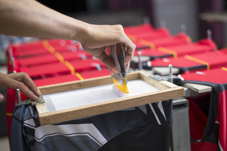 Handmade screen printing t-shirt is an important step of craftsmen, Close-up