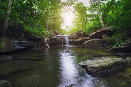 Small waterfall in tropical forest, Streams of water are pouring, Nature during the rainy season.
