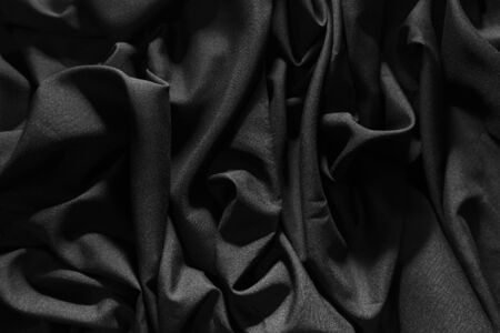 Wrinkled gray fabric, Light hits, Dark pattern background.