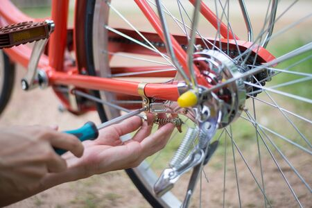 Checking bicycle brake, person is fixing the bicycle brake, Close-up