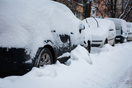parking cars in a heavy snowfall in the town of winter Reklamní fotografie