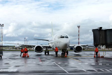 Airplane on refueling in an airport. Technical service and preparation to flight