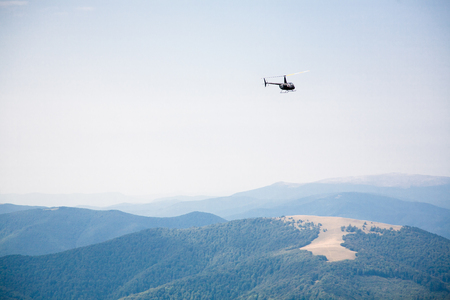 helicopter in the mountains, summer landscape, transport and rescue