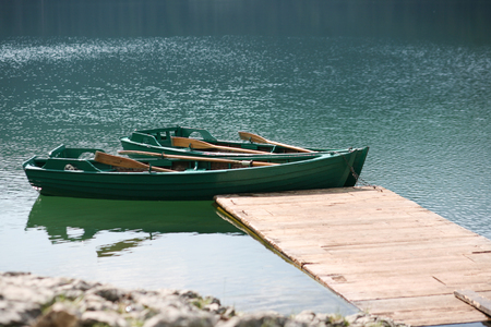 Boats on the turquoise waters of the Black Lake, Montenegro