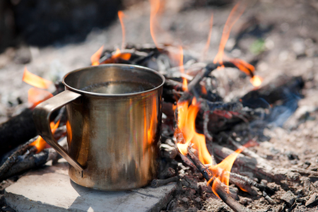 Camping cooking on a campfire outdoor, tourist kettle on fire Reklamní fotografie