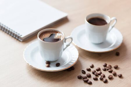 Two cup of turkish close-up on a wooden background, coffee beans. Pleasant morning and cheerfulness, mood Reklamní fotografie