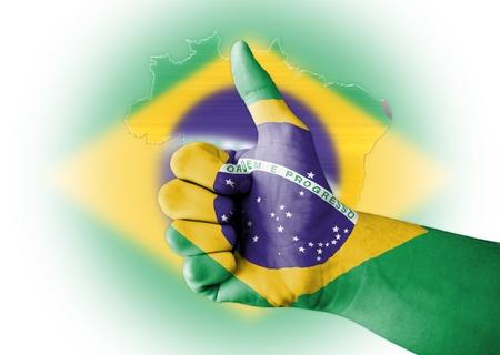 stock predictions: Pollice in su con digitale corpo dipinto a bandiera Brasile