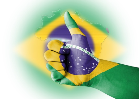 Thumb up with digitally body-painted Brazil flag Stock Photo