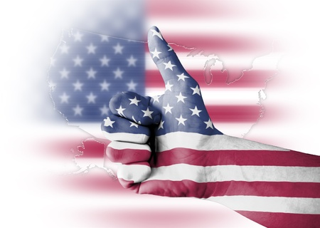 Thumb up with digitally body-painted USA flag photo