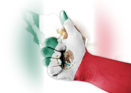 Thumb up with digitally body-painted Mexic flag Stock Photo - 12764464