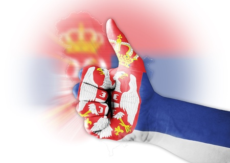 sell shares: Thumb up with digitally body-painted Serbia flag